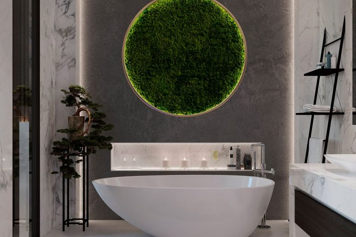 The free-standing bath with backlit vertical garden above and wall recess for bathroom goodies.