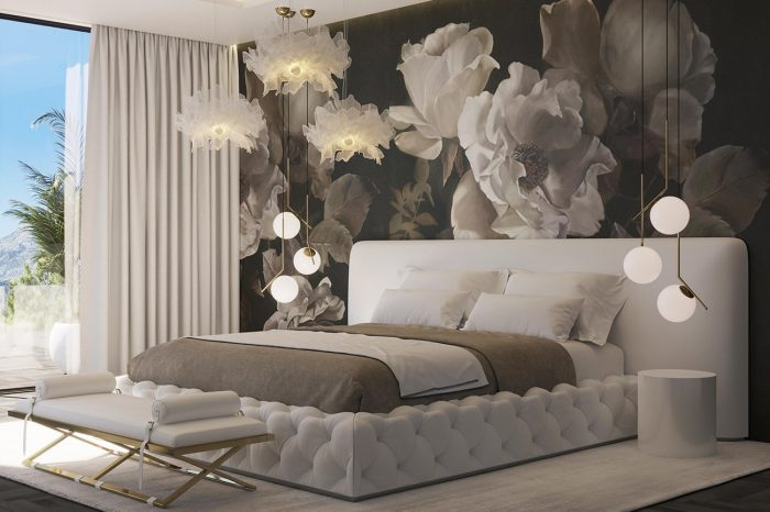 The off-white velvet bed and headboard are set against a dark floral mural, creating a calm, yet vibrant atmosphere.