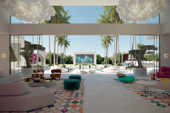 Impressive view: the main lounge area extends effortlessly into the villa's own palm tree boulevard, with a giant LED screen at the end.