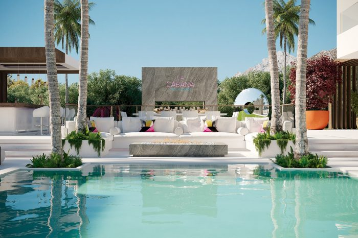 The pool area: the neon La Cabana sign may not be a geographical necessity, but true to the somewhat quirky design of the entire villa, it is an essential design element, as well as a reminder that entertaining is taken seriously in this house. The white sofas are custom-made by UDesign.