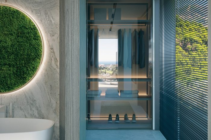 Master Bathroom: the walk-in wardrobe is connected to the bathroom by a small, naturally lit hallway.