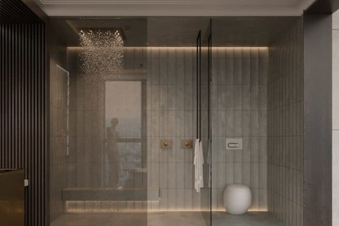 The shower area, opposite the bath, includes a practical bench seat