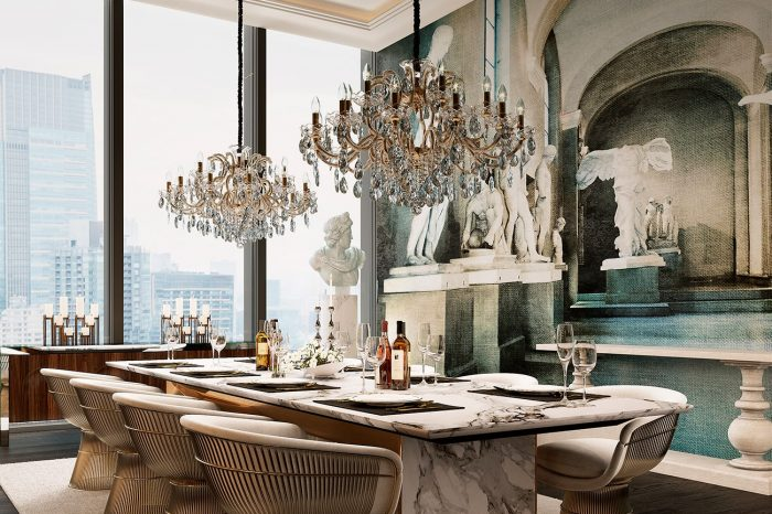 Imposing Masiero chandeliers hover majestically over the solid stone dining table, custom-made by UDesign