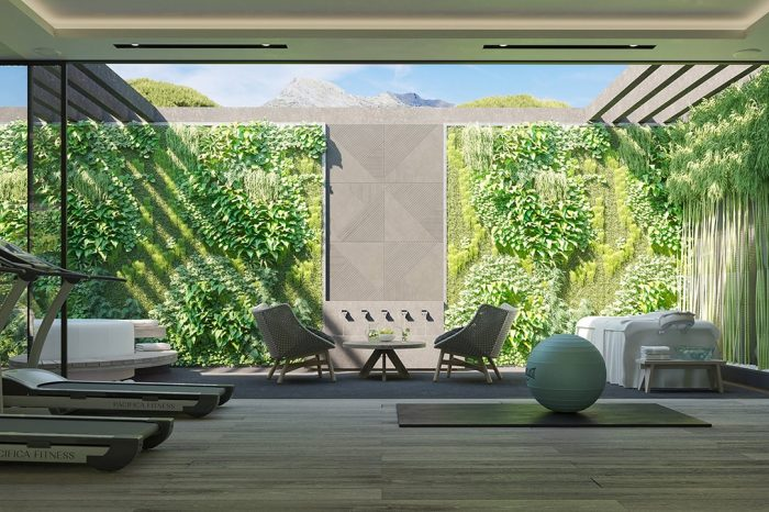 An English patio with a vertical garden and a fountain water feature bringing water elements inside the spa area