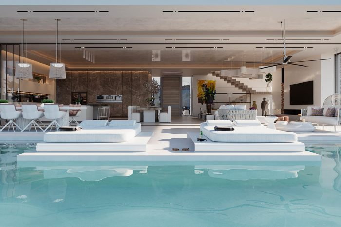 View across the pool and day beds into the living area.