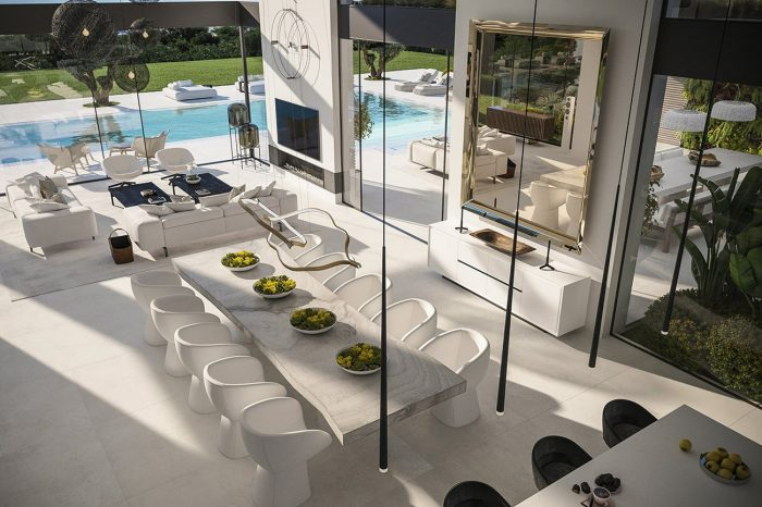 View of the living space from the office - the protagonist of the space is, undoubtedly, a Caadre mirror designed by Philip Starck for Fiam Italia