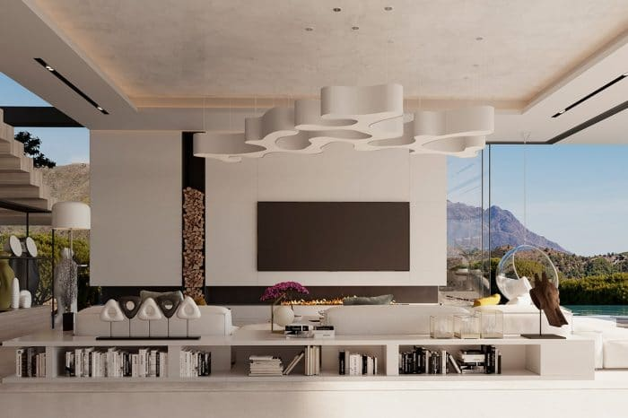 The TV area has a 5-metre-wide TV wall with a modern fireplace. The stacked wood shifts the focal point so that the TV is centreed both with sofa and the wall.