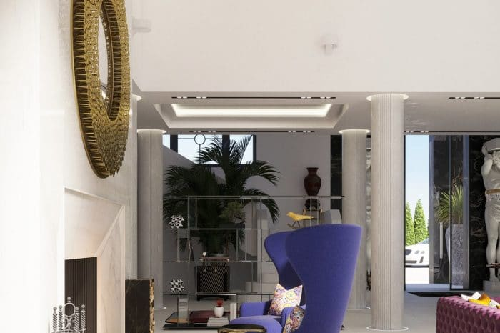 Tom Dixon chairs in front of the open fireplace