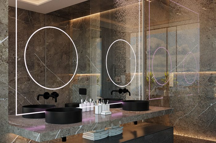 The master bathroom is made entirely of dark marble with inky wood and a touch of neon lighting, it gives an urban, art-smart feel to this intimate space.