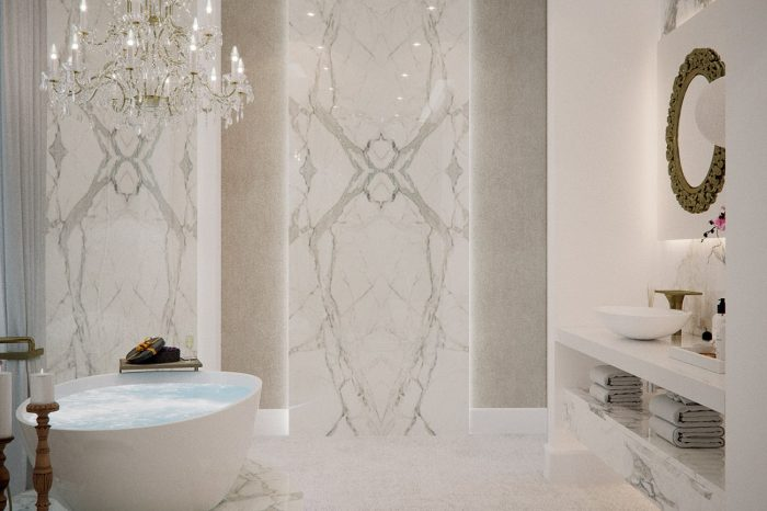 """Her"" bathroom couldn't be more feminine and elegant. Marble plinth for the bath matches the panels surrounding it"