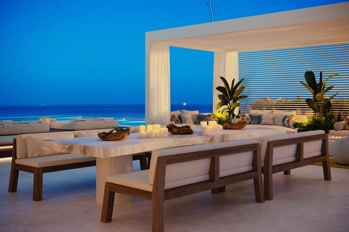 The dining area has a view to the sofa area, the big screen and the sea. Spoilt for choice!