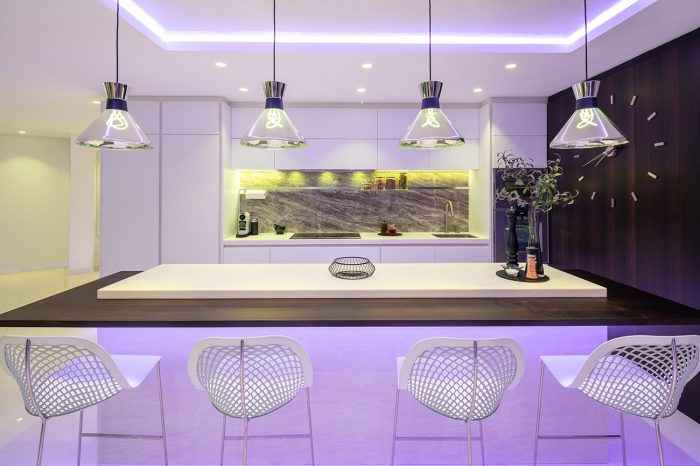 Kitchen Island with Plumen lamps, Nomen wall clock, Gaggenau oven and microwave.