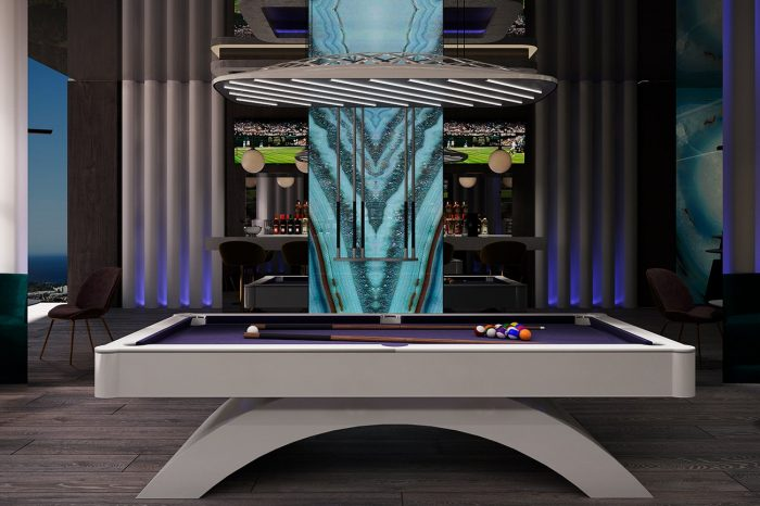 The pool table and sports/cocktail bar