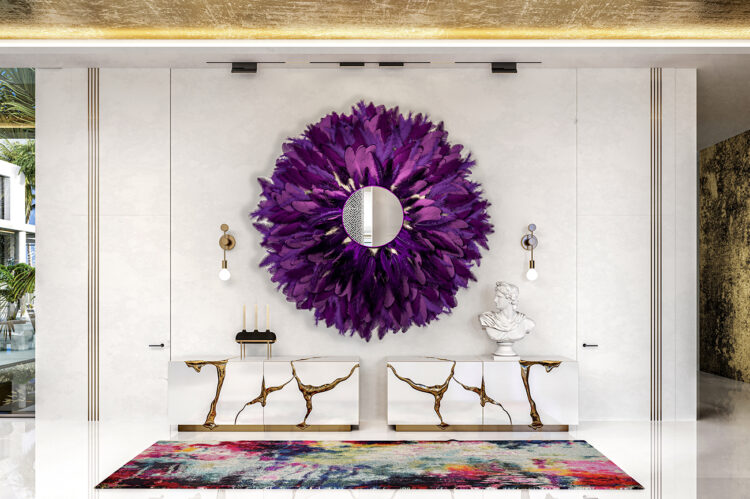 Purple feather mirror hangs above two Boca do Lobo cabinets