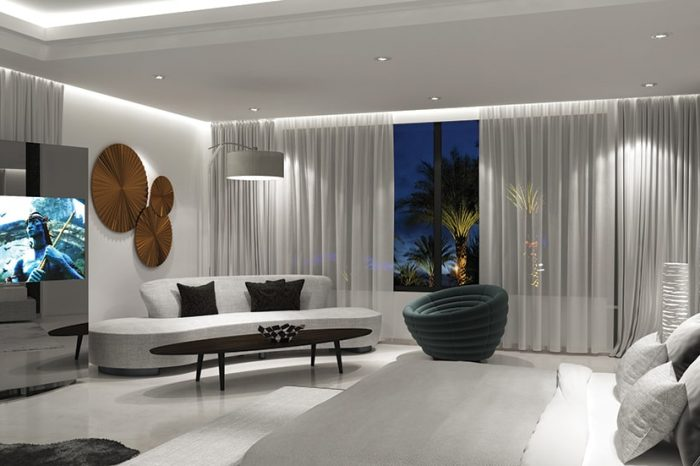 Designer furniture and contemporary lighting complete this spacious bedroom suite