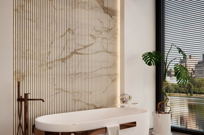 Bath with a view. Beautiful grooved marble panel behind the bath.