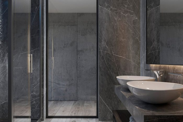 The dominating colour palette of black, grey and white continues in the bathrooms