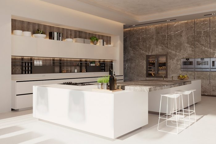 The island units in the kitchen are slightly suspended so they look like they're floating. Natural stone effect porcelain tile for the bar of the kitchen island and floor standing cabinets.