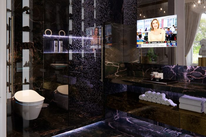 """""""His"""" bathroom with the striking dark natural stone, double shower and touches of neon lighting"""