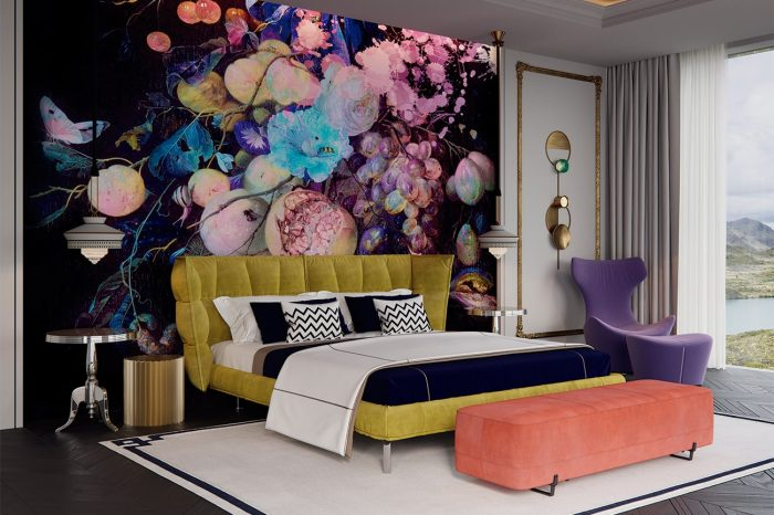 The vibrant palette continues into the master bedroom, where a combination of green, purple and coral is completed with brightly-coloured floral wallpaper. Bed and purple occasional chair by B&B Italia.