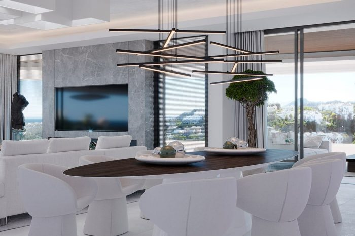 The dining table, custom made by UDesign, is complemented by the sculptural white Armada chairs from Moroso