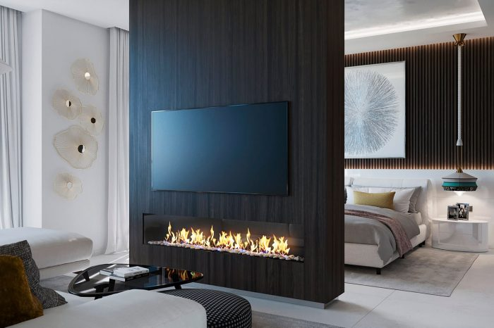 The bedroom and lounge are open plan yet separate, divided by a central column with a large screen on both sides and the fireplace below, enjoyed by both spaces.