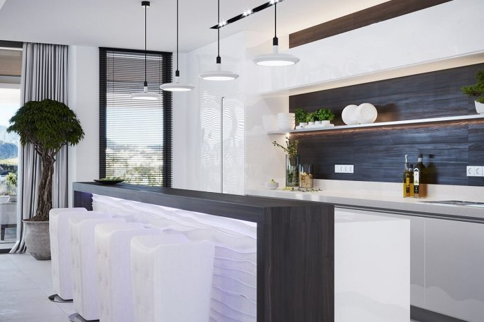 The kitchen with a backlit breakfast bar in eucalyptus wood