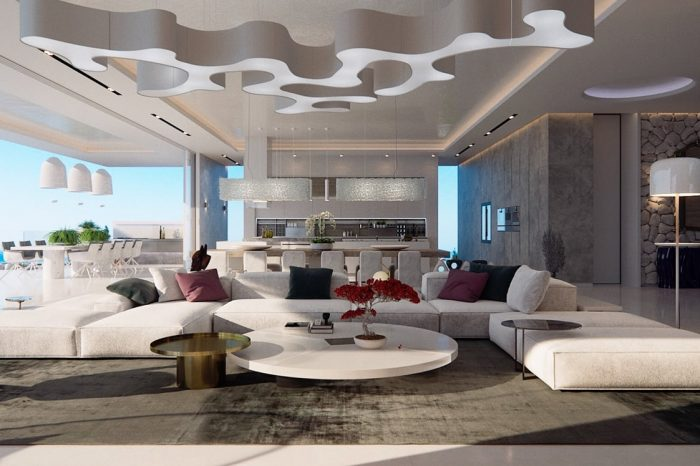 The bright and spacious living area with its giant ceiling sculpture, perfect for the size of the room.