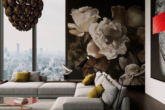 Comfortable designer sofas with a backdrop of floral wallpaper