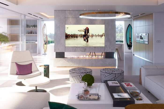 Living area with kitchen behind screen