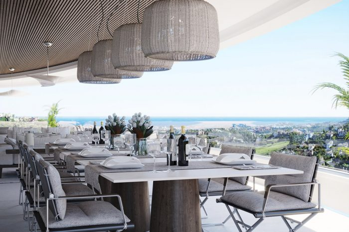 The terrace dining table with eucalyptus wood base matching the detailed ceiling