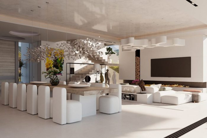 Dining area with TV area behind. An Argent Chandelier by Terzani hangs above the dining table. Once lit, the multiple, angled surfaces of the discs emanate a soft, shimmering glow.