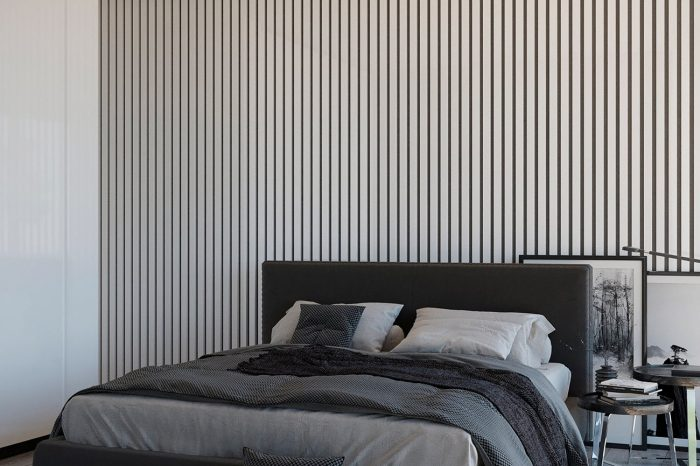 The guest bedroom has a striking lacquered wall panel behind the bed