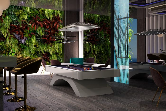 Pool table and bar area. The wall of greenery leads onto a terrace.