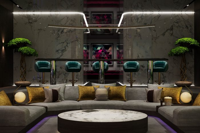 This sunken cinema seating area and the bar stools behind can accomodate up to 14 people