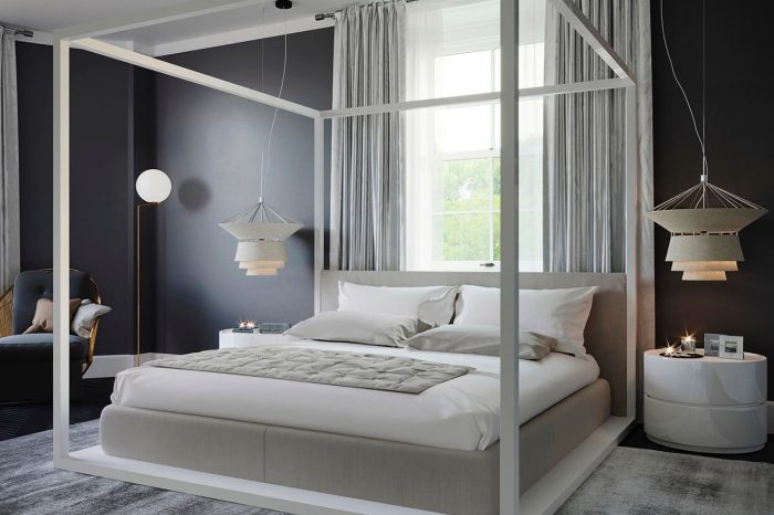 This guest bedroom with its neutral palette of grey, beige and white makes for a relaxing environment